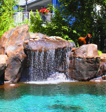 Swimming Pool Waterfall Designs landscaping and outdoor building swimming pool waterfalls pool waterfalls with slide Grotto Waterfalls With Underwater Benches Allow Swimmers To Sit Under The Cascading Water