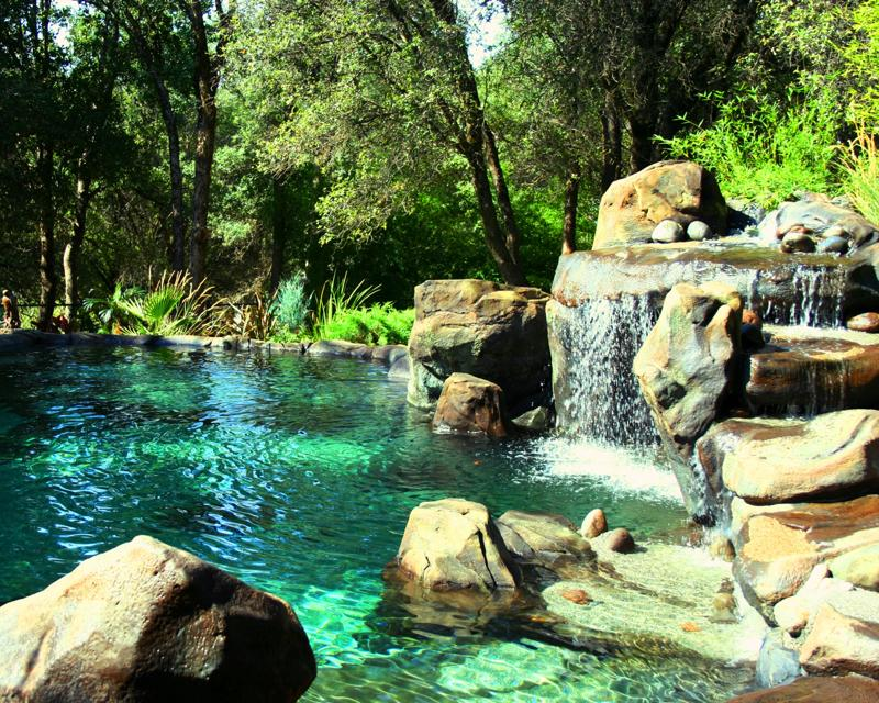 Natural swimming pool ideas on pinterest natural for Natural rock landscaping