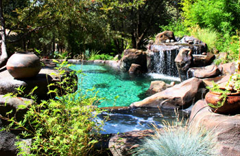 the landscape fits this swimming pool and waterfall perfectly - Swimming Pool Landscape Designs